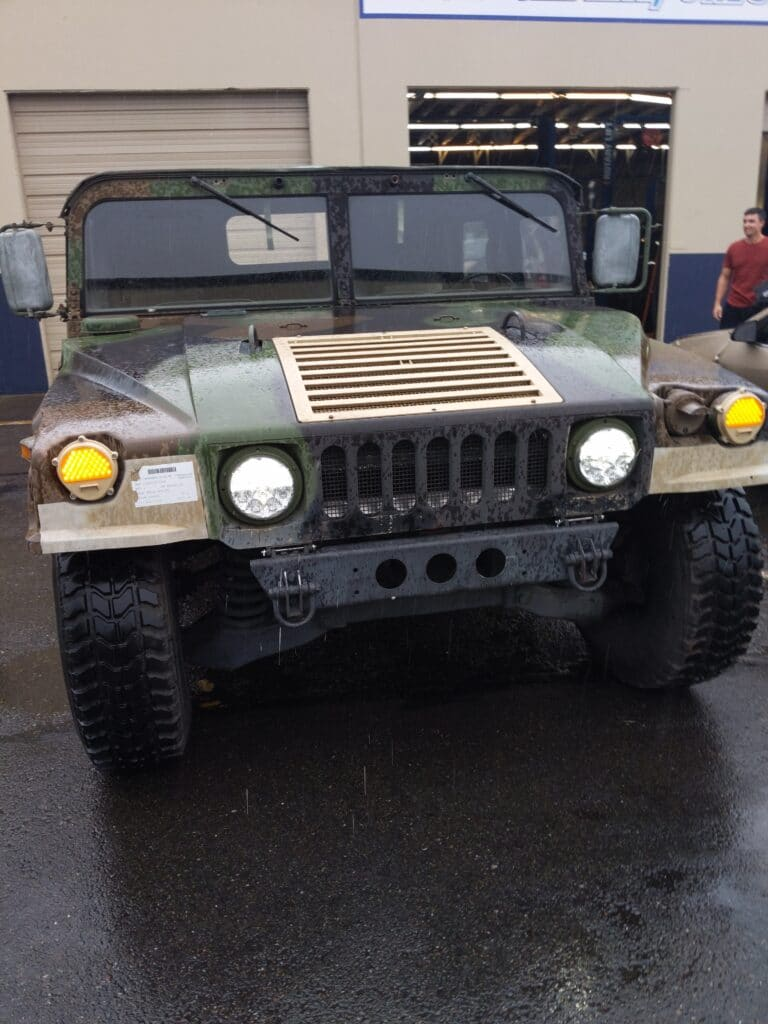 old military SUV in the rain