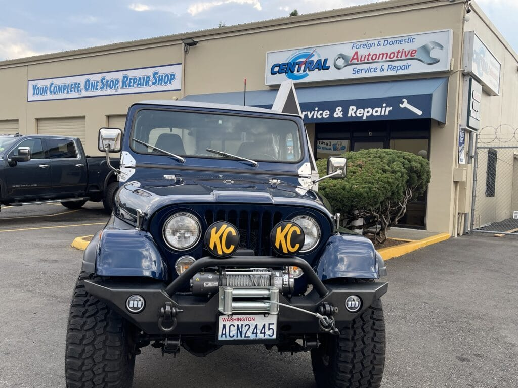 Blue Jeep in front of Central Avenue Automotive