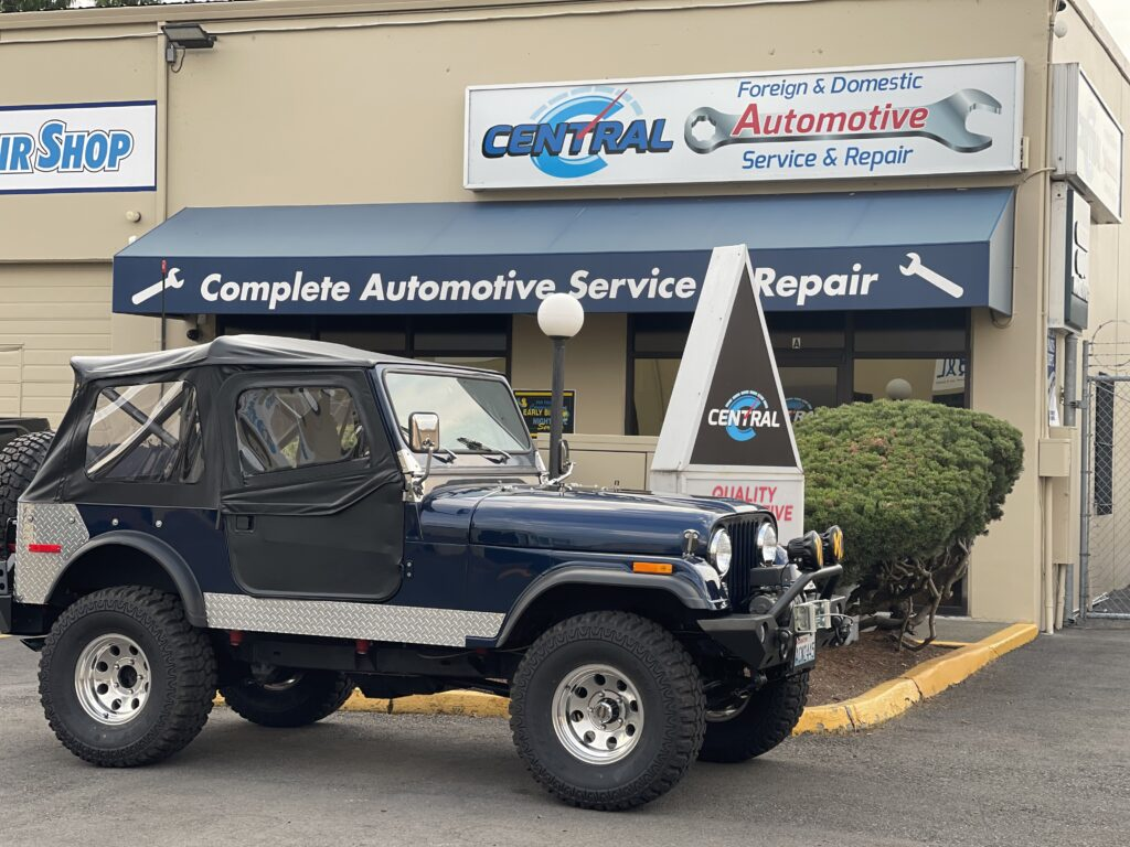 Two Door Jeep Wrangler in front of Central Avenue Automotive