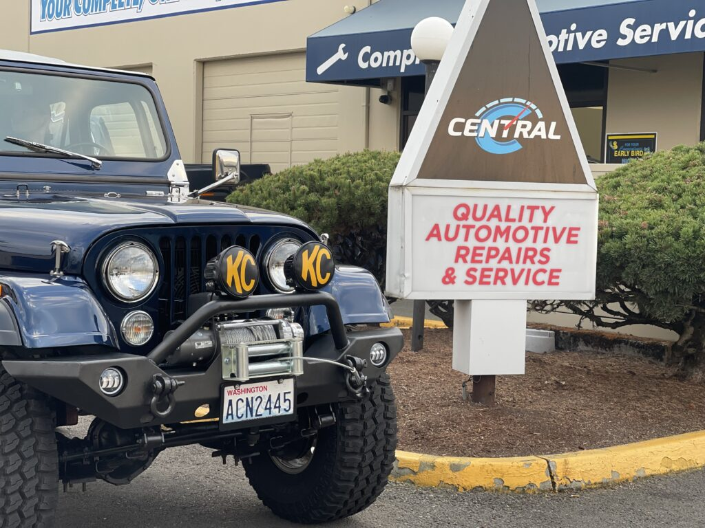 Blue Jeep Wrangler Central Avenue Automotive Sign